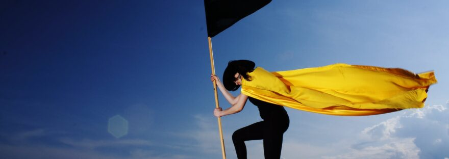 woman holding black flag