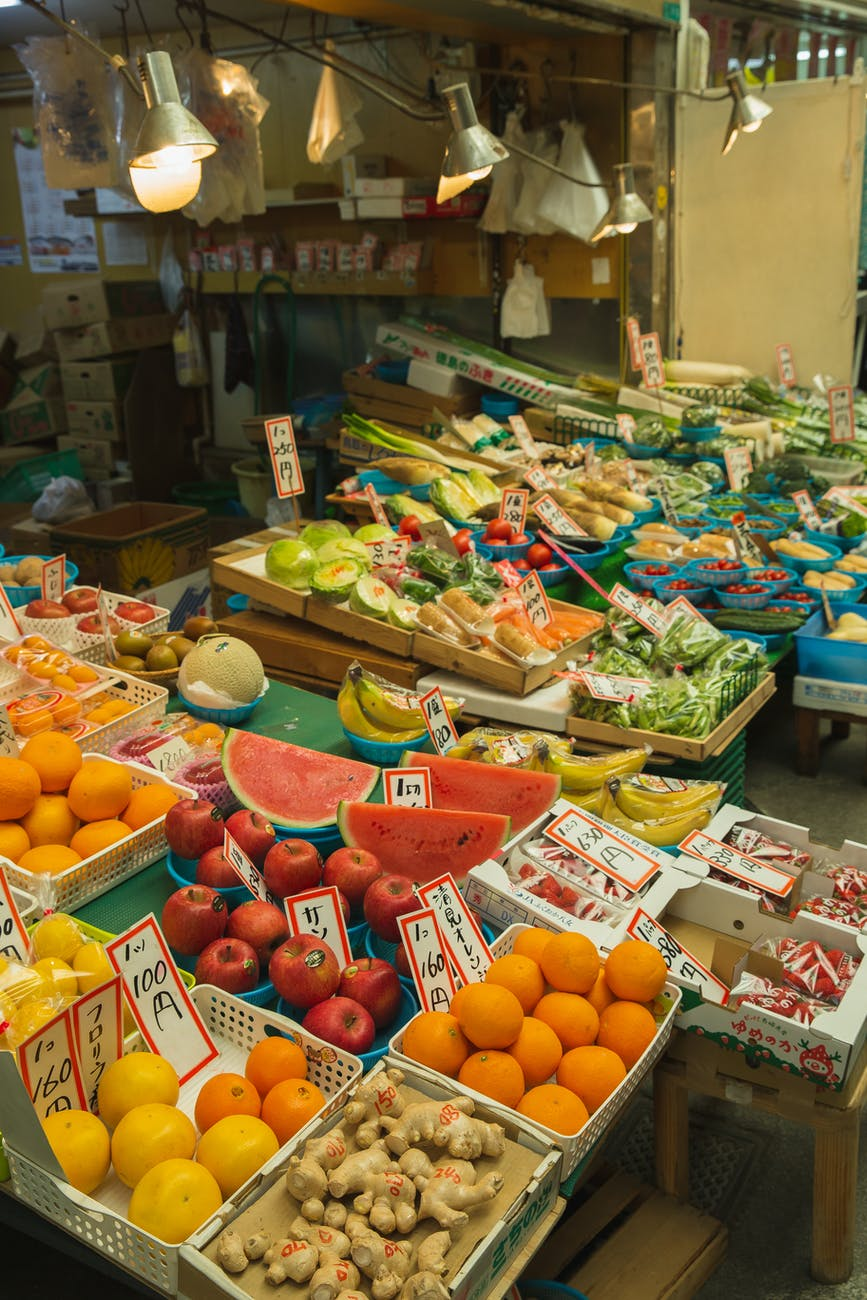 colorful fruits and vegetables placed on counter in local market