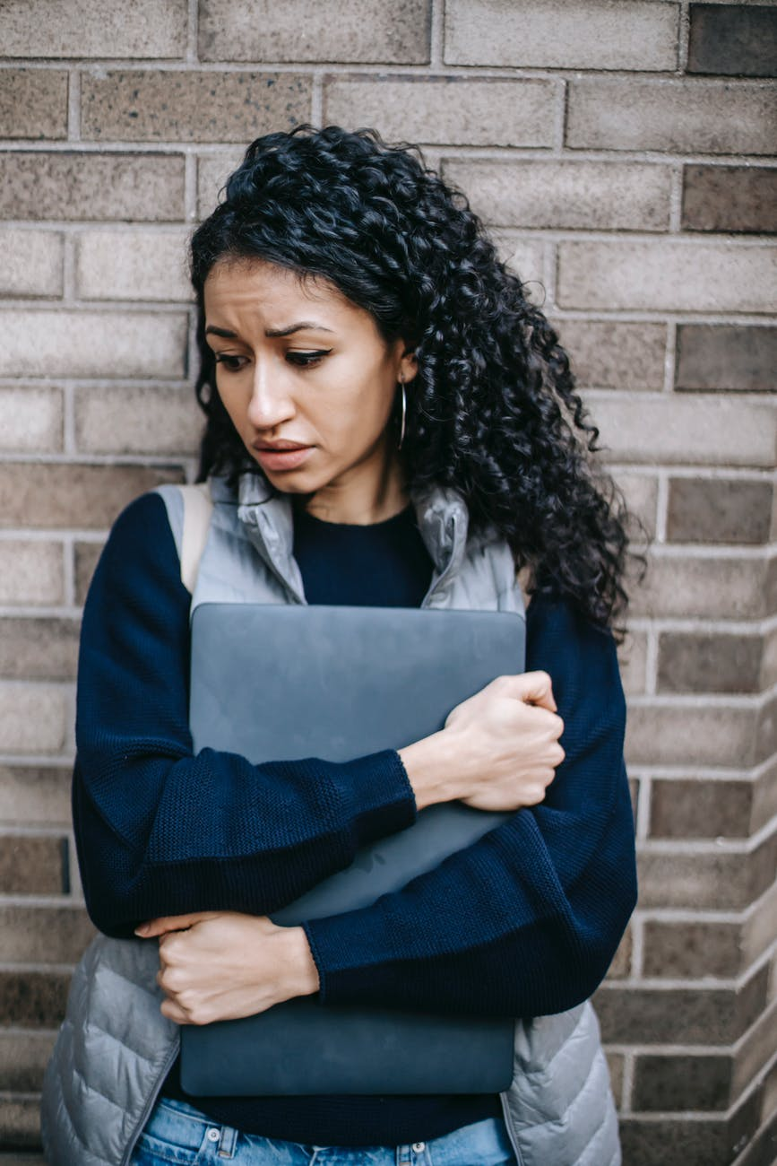 unhappy latin american woman with laptop
