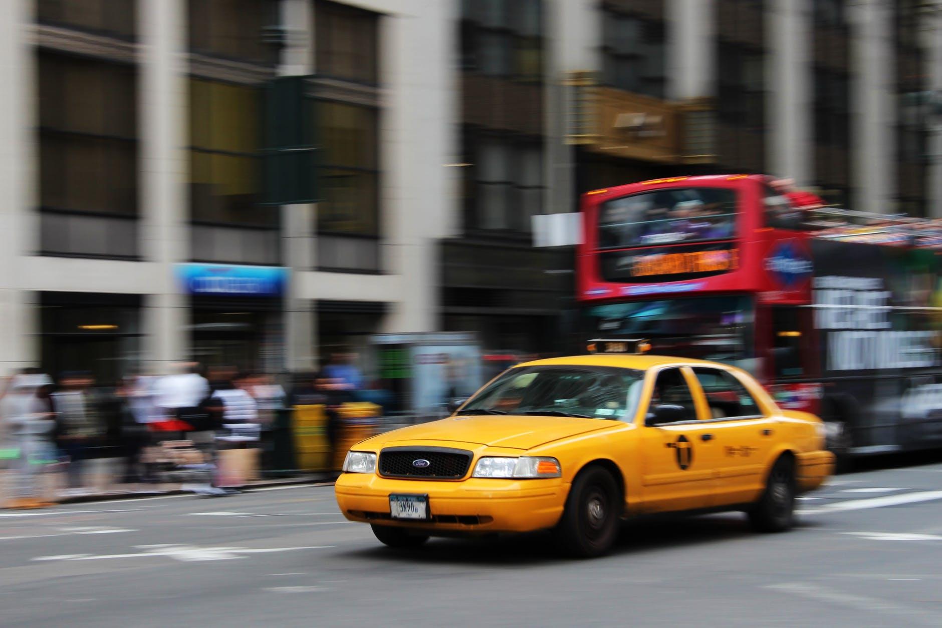 selective focus photography of yellow sedan
