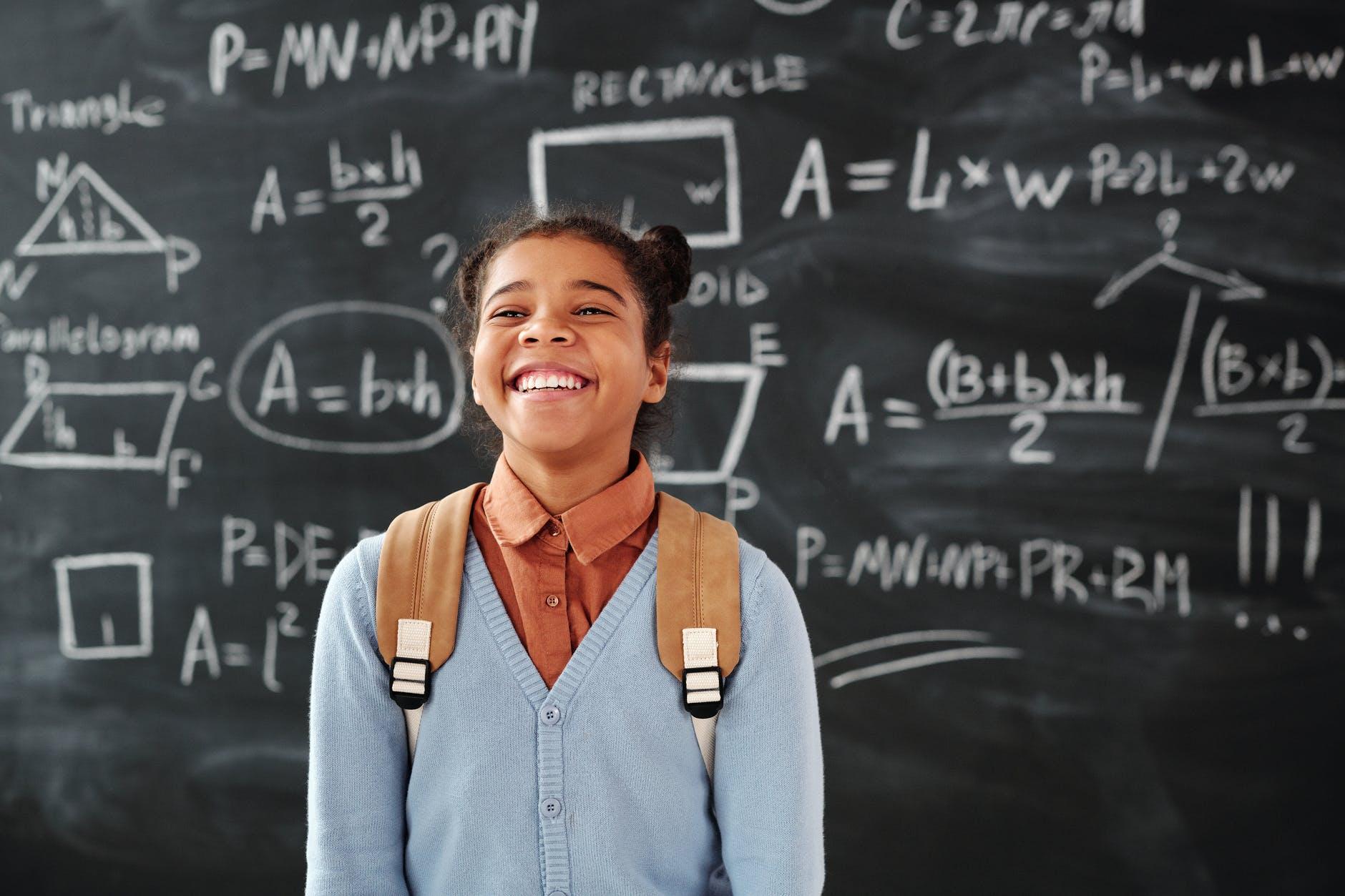 girl writing mathematics school