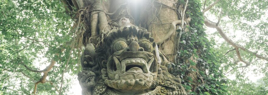 statue of mythical creature in rainforest