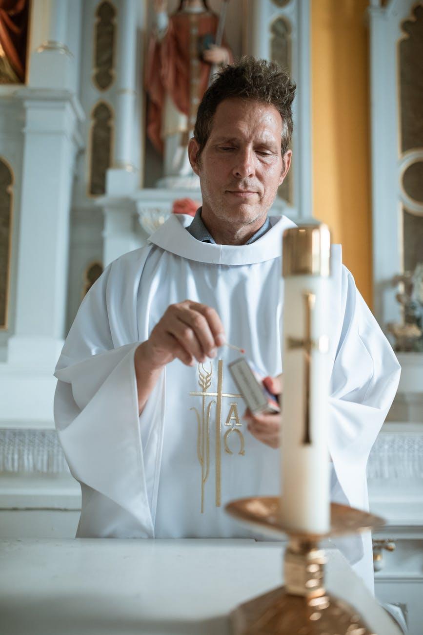 man in white thobe holding white stick