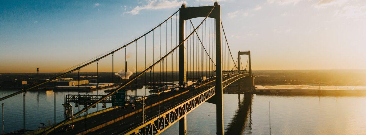 majestic suspension bridge over river in bright sunshine