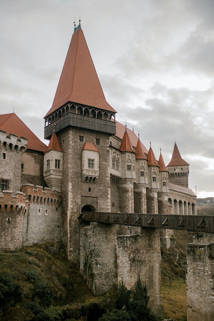 gothic majestic castle under cloudy sky