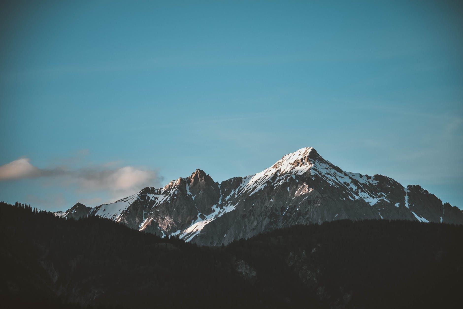 snow top mountain under clear sky
